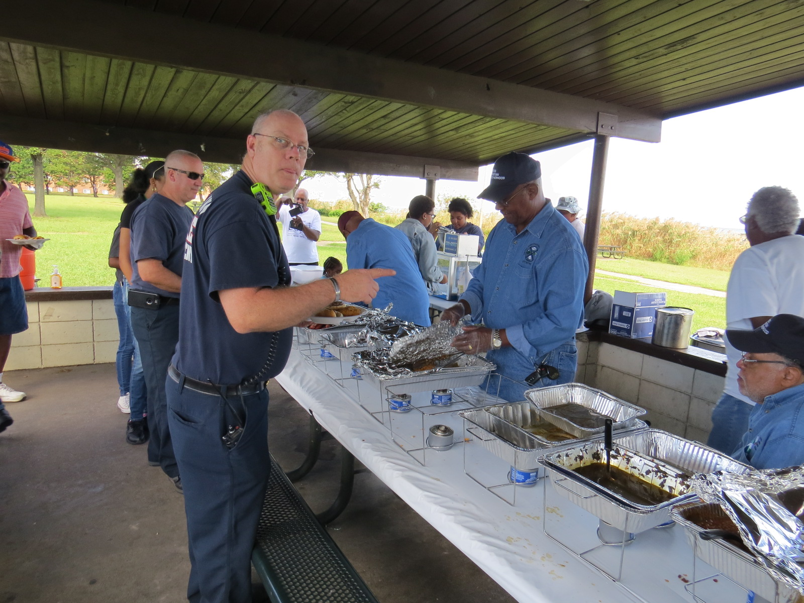 Fire Fighters feasting at the 2017 Family Day celebration
